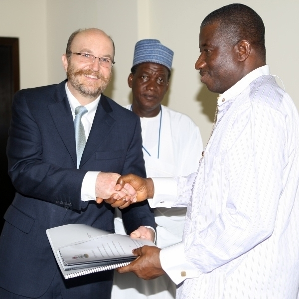 Seaforth President David Lombardi presenting the Extended Continental Shelf Submission to Nigeria President Goodluck Jonathan and Nigeria National Boundary Commission Director-General Saddiq Diggi at Abuja